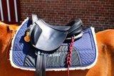 Photos of pads under various saddles_